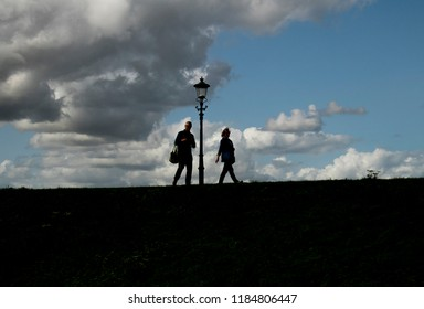 Netherlands,North-Holland,Medemblik,july 2018:People walking on a dike against a bright sky