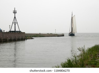 Netherlands,North-Holland,Medemblik,july 2018:ship enters the harbor of Medemblik