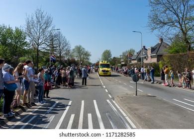 Netherlands,Sassenheim-21 April 2018:Bulbflower Parade 2018,Bloemencorso BollenStreek,Ambulance on road