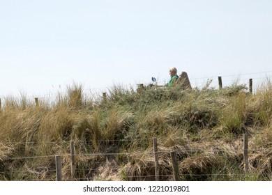 Netherlands,south holland,Noordwijk,august 2017:People walking in the dunes