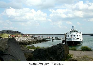 Netherlands,zeeland, Eastern Scheldt storm surge barrier july 2016: passengers entering cruise ship at the Former construction island the Neeltje Jans