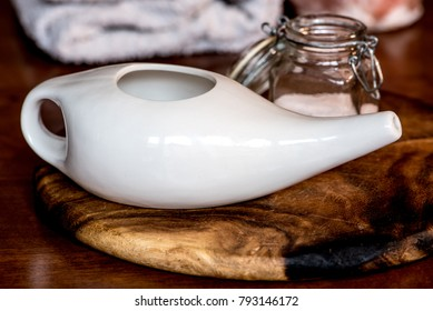 neti pot, ayurvedic tools for cleaning nose with water and salt,  on a wooden table