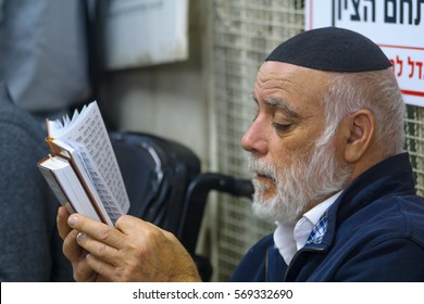 NETIVOT, ISRAEL - JANUARY 30, 2017: Jewish man pray at the Rabbi Israel Abuhatzeira (Baba Sali) tomb, as part of the annual hillula of his memory. In Netivot, Israel