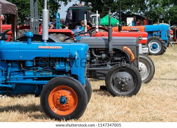 Netley Marsh, United Kingdom - July 21 2018:   A row of farm tractors seen at Netley Marsh steam fair