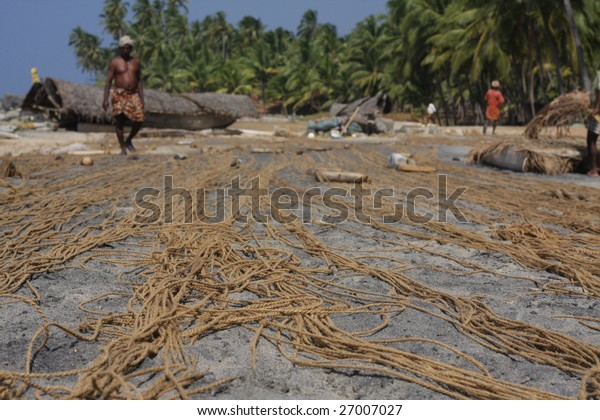 nets of fishermen drying on the ocean shore