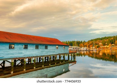 A netshed reflects in the still waters of the Puget Sound in Gig Harbor, Washington.