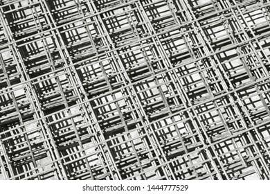 Netting. Steel-mash reinforcement in an industrial landscape