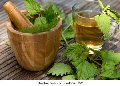 Nettle nettle leaves tea vegetarian drink mortar vitamins health wooden background