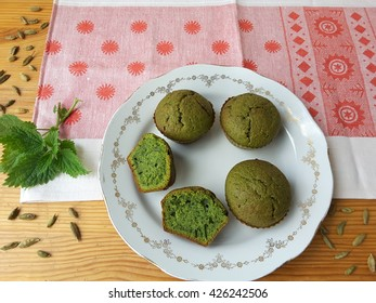 Nettles green muffins with cardamom on plate