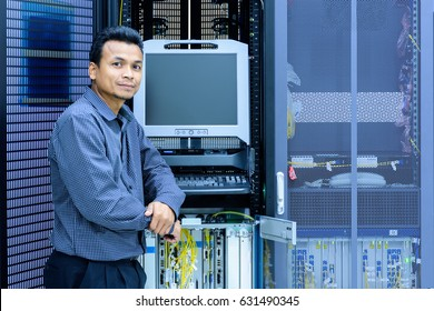 Network administrator working in data center room