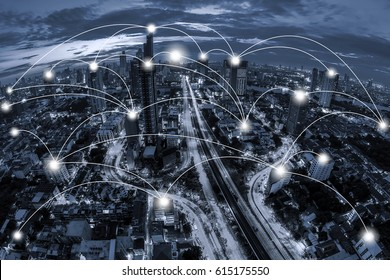 Network business conection concept on blue tone Aerial view of cityscape Bangkok business district at twilight  background.