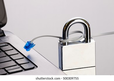 Network cable, laptop, padlock; online/internet security concepts