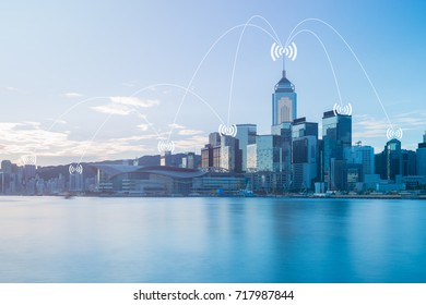 Network conection concept on blue tone cityscape business district background.
