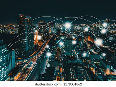 Network and connection technology concept with aerial view of Tokyo, Japan at night