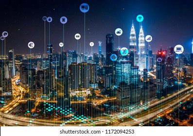 Network and Connection technology concept with City night view and skyscraper in business district in KL city, Malaysia