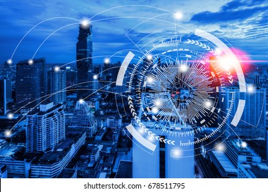 Network connection technology concept on blue tone aerial view of cityscape business district at twilight background.
