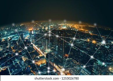 Network and Connection technology night city background at business center bangkok thailand. Wireless skyline connection with energy light infographic.