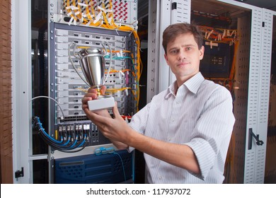 Network engineer in server room with the cup