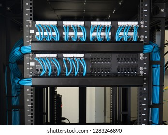 Network ethernet cables and path panel in rack cabinet