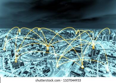 network graphic above invert city scape, network connection concept in invert bluetone