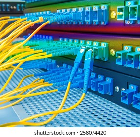network hub and patch cables,Fiber cables connected to servers in a datacenter