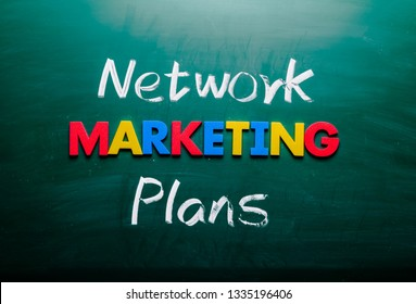 Network marketing plans concept. Colorful and handwriting words on blackboard.