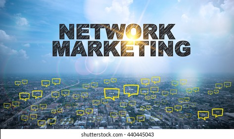 NETWORK MARKETING text on city and sky background with bubble chat ,business analysis and strategy as concept