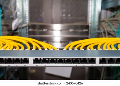 Network Patch Panel in a datacenter with network cables in front view
