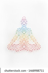 Network of pins and threads forming yoga lotus pose symbolising connection to inner self.