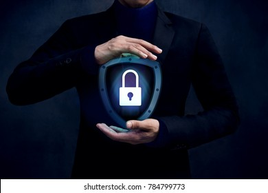 Network Security System Concept, Locked Key inside a Shield Guard, Protected by Careful Gesture Hands of Businessman