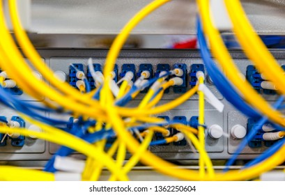 Network server room routers with fusebox panel blurred front background. Datacentre interface and equipment.