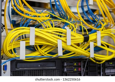 Network server room routers with fusebox panel. Neatly twisted wires. Datacentre interface and equipment. Network and technology futuristic concept