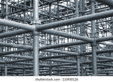 Network of steel pipes in a construction grid.