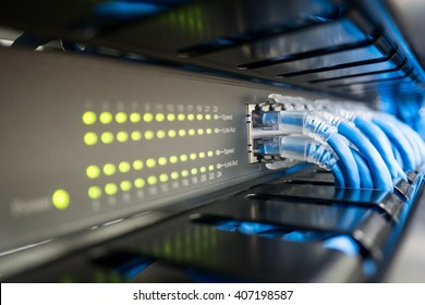 Network switch and ethernet cable in rack cabinet. Network connection technology and has a status LED to show working status. Concept of infrastructure with cables connected to data center