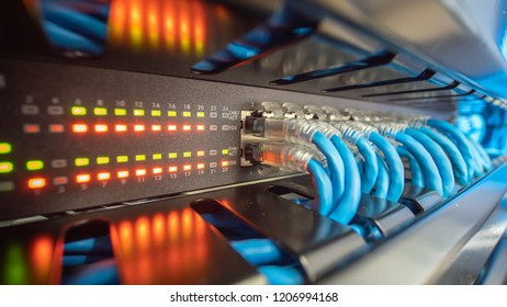 Network switch LED status and ethernet cable connect to computer local area network system