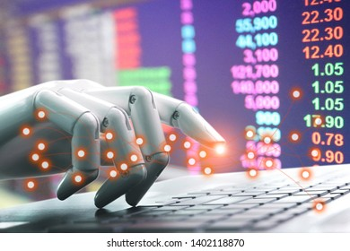 Network technology chatbot robot hand pressing computer keyboard enter of Investment in the puppet market