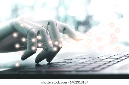 Network technology robot concept or robot hand chatbot pressing computer keyboard enter