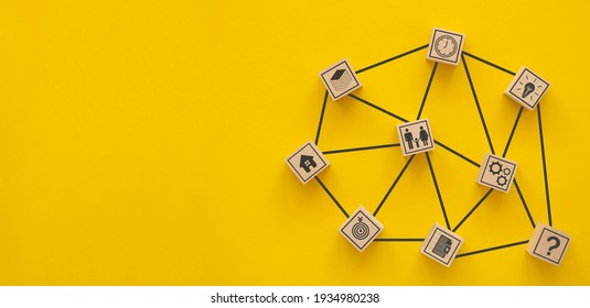 Network. Wooden blocks connected together on a yellow background. Teamwork concept.