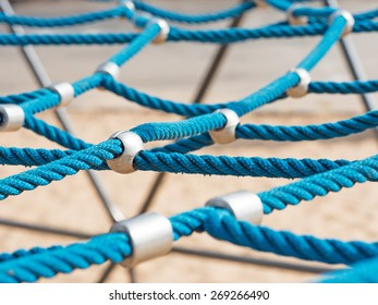 networked blue ropes on a climbing frame
