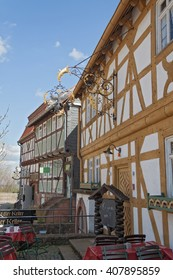 NEU ANSPACH, GERMANY - APRIL 18, 2016: old wrought iron sign on a half timbered house in the open air museum Hessenpark, Neu Anspach, Germany