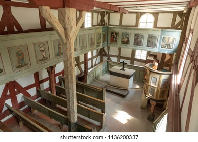 NEU ANSPACH, GERMANY - JUL 16, 2018: old village church  at Hessenpark in Neu Anspach. Since 1974, more than 100 endangered buildings have been re-erected at the Hessenpark Open-Air Museum.