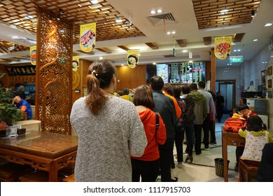 Neu Jie, Beijing, China. April 28, 2018 : Customers queued in a restaurant to buy food for breakfast