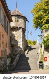 NEUCHATEL, SWITZERLAND - SEPT.05.2018: Street with staircase and tower