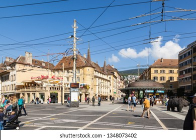NEUCHATEL, SWITZERLAND - SEPTEMBER 05, 2018: Urban scene, view of tram system infrastructure at crossroad in the city with a population of approx. 34000 mainly French-speaking residents