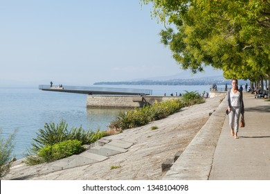 Neuchatel,Switzerland-Sept.05.2018:Neuchatel lake in Switzerland seen from the port promenade of Estavayer-le-Lac, with plants and flowers.