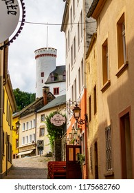 NEUERBURG, GERMANY - AUGUST 03, 2014: Neuerburg street view with the building of the clergy house, a former governor's residence at the far end