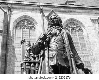 The Neues Bach Denkmal meaning new Bach monument stands since 1908 in front of the St Thomas Kirche church where Johann Sebastian Bach is buried in Leipzig Germany in black and white