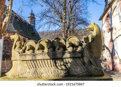 Neumagen, Germany - February 20, 2021: stone statue of  the ship of a wine merchant with barrels in Neumagen Dhron from roman times.