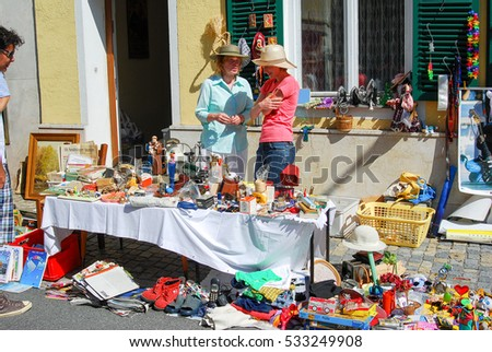 427478329d Neuoetting,Germany- June 16,2009 : Two women stand behind a table selling