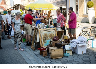 Neuoetting,Germany-August 19,2018: People look at the different wares on sale at a sunday flea market